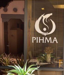 PIHMA logo on Window